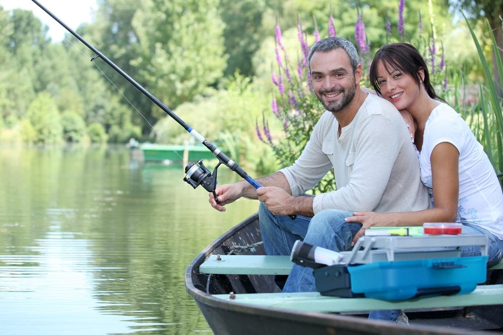 Couple embracing while fishing.