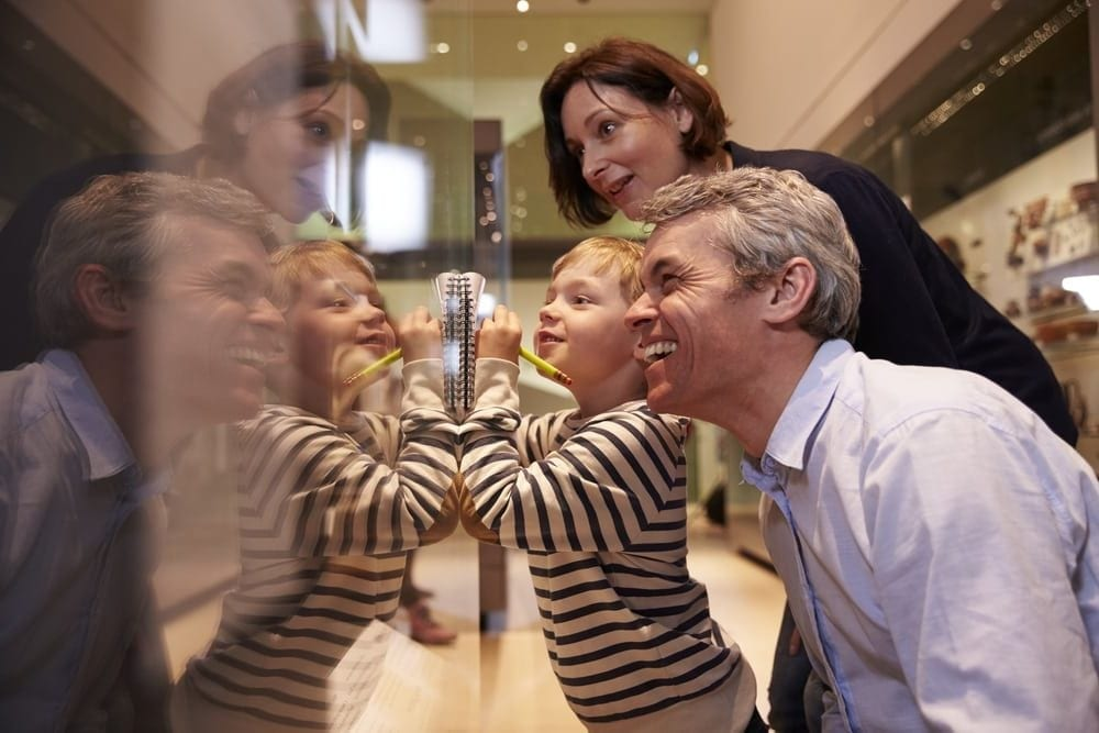 Family looking at a museum display.