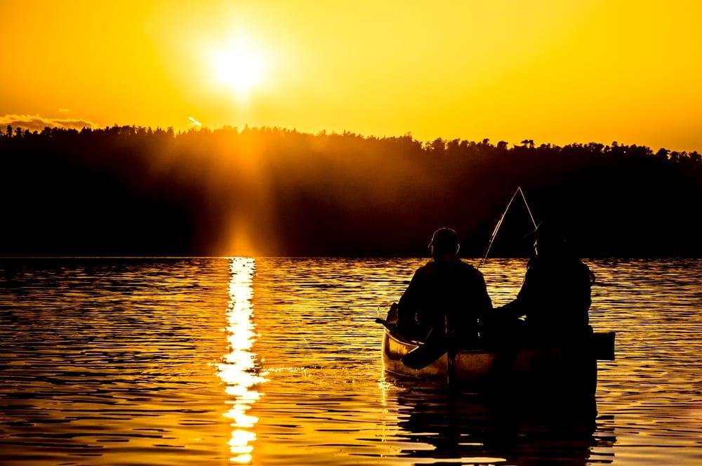 Fishermen on the lake at sunrise.