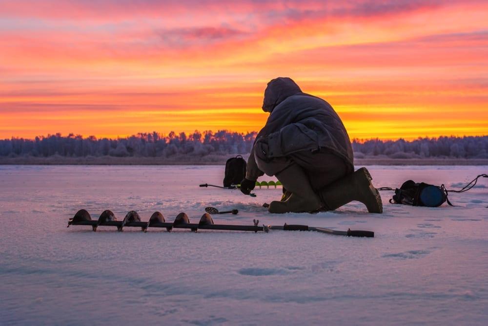 Ice fisherman with ice borer.