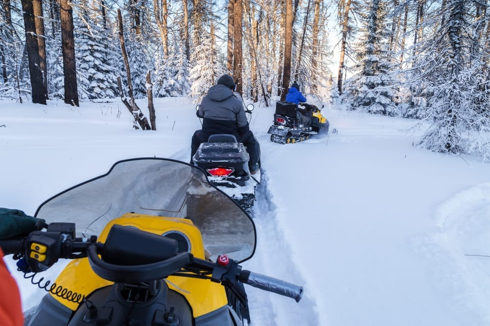 Snowmobiling through Lake of the Woods